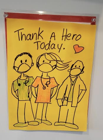 Poster with Doctors and Nurses:  Thank a Hero Today!